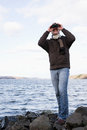 A man using binoculars Royalty Free Stock Photography