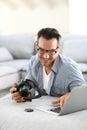 Man using camera and laptop Royalty Free Stock Photo
