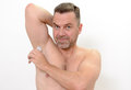 Man using a deodorant because to avoid odor Royalty Free Stock Photo