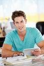 Man Using Digital Tablet In Bu...