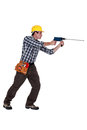 Man using drill with long bit Stock Images
