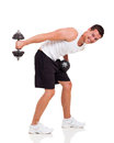 Man using dumbbells handsome young isolated on white background Royalty Free Stock Photography