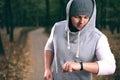 Man using fitness bracelet Royalty Free Stock Photo