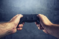 Man using gamepad controller to play video games Royalty Free Stock Photo