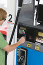 Man Using His Debit Card To Pay For Gasoline Stock Photos