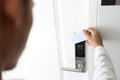 Man using keycard contactless for unlock door in hotel. Royalty Free Stock Photo