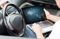 Man using laptop computer in car Royalty Free Stock Photo