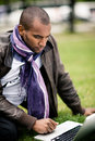 Man using laptop on grass Royalty Free Stock Photo