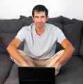 Man using laptop looking at camera Royalty Free Stock Photography