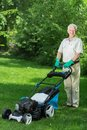 Man using the lawnmower Royalty Free Stock Photo