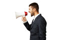 Man using megaphone over white young shouting background Stock Images