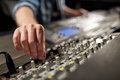 Man using mixing console in music recording studio Royalty Free Stock Photo
