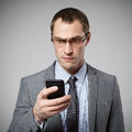 Man using mobile smart phone on gray background Royalty Free Stock Images
