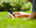 Man using mobile smart phone outdoor in summer Royalty Free Stock Images