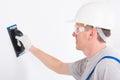 Man using plastering trowel Royalty Free Stock Photo