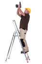 Man using a screwdriver whilst up ladder Royalty Free Stock Photography