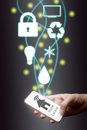 stock image of  Man using smart phone internet of things concept. home control o