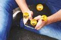 Man using smartphone sending emojis.