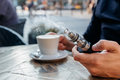 Man using vape or electronic cigarette and drinking coffee Royalty Free Stock Photo