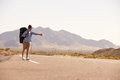 Man On Vacation Hitchhiking Along Country Road Royalty Free Stock Photo