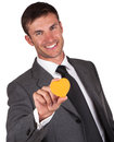 Man and valentines businessman with an orange heart in hand on valentine s day Royalty Free Stock Images