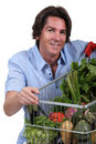 Man with vegetable trolley Stock Photos
