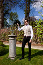 Man in vicorian clothing and sundial in the park victorian or edwardian pillar summer Royalty Free Stock Photos