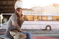 Man waiting at the bus station and talking on the mobile phone Royalty Free Stock Photo