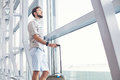 Man waiting for his flight in the international airport handsome Royalty Free Stock Photo