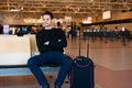Man waiting for his flight Royalty Free Stock Photo