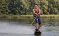 Man wakeboarder on pond in park Royalty Free Stock Photo