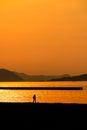 Man walk on sunset beach Royalty Free Stock Photo