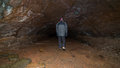 A man walking in a cave. Royalty Free Stock Photography