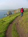 Man walking on a coastal hiking path, south england Royalty Free Stock Photo