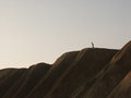 Man walking down a hill Stock Photography