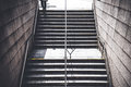 A man walking down stairs to go to underground train station. Royalty Free Stock Photo
