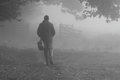 Man walking in fog Stock Image