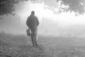 Man walking fog 1 Royalty Free Stock Photo