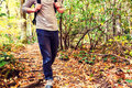 Man walking on a forest path Royalty Free Stock Photo