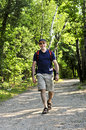Man walking on forest trail Royalty Free Stock Image