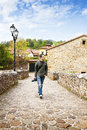 Man walking handsome young photographer at spanish ancient village Royalty Free Stock Image