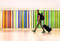 Man walking at international airport with travel suitcase Royalty Free Stock Photo