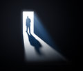 Man walking out into light Royalty Free Stock Photos