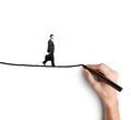 Man walking on rope hand drawing businessman Royalty Free Stock Photography