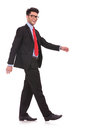 Man walking sideways & looking at you Royalty Free Stock Photo