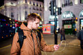 Man walking in the streets of London at night Royalty Free Stock Photo