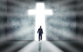 Man walking towards cross a huge passage Stock Photo