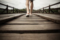 Man walking on a wooden bridge Royalty Free Stock Photo