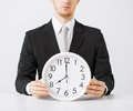 Man with wall clock close up of holding Royalty Free Stock Photography