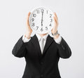 Man with wall clock covering his face Royalty Free Stock Images